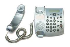 Téléphone et pipe photographie stock
