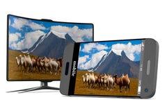 Téléphone et TV sur le fond blanc 3D d'isolement Photographie stock libre de droits