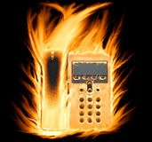 Téléphone flamboyant photographie stock