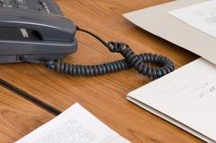 Téléphone gris au bureau. Photographie stock libre de droits