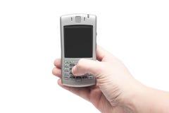 Téléphone intelligent avec le clavier QWERTY à disposition Photographie stock