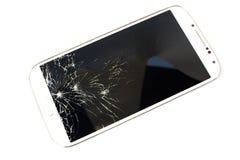 Téléphone intelligent blanc cassé sur le fond blanc Photos libres de droits