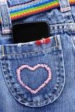 téléphone intelligent dans la poche de jeans Photographie stock