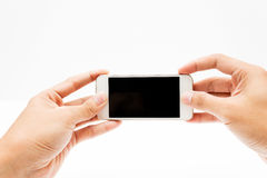 Téléphone intelligent de prise de main Photographie stock