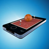 Téléphone intelligent, mobilophone avec le match de basket Photographie stock libre de droits
