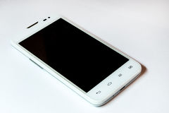 Téléphone intelligent moderne dans la couleur blanche D'isolement Photo stock
