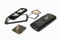 téléphone mobile de pièces Photo stock
