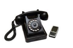 Téléphone neuf et vieux photographie stock libre de droits