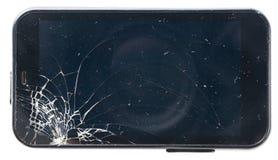 Téléphone noir avec l'écran cassé Photo stock