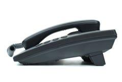 Téléphone noir de bureau. Vue de côté photo stock
