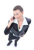Téléphone parlant de mobole de femme d'affaires Photos libres de droits