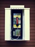 Téléphone payant avec des effets de vintage image libre de droits