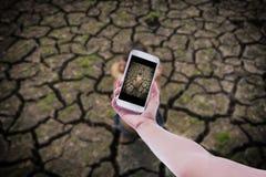 Téléphone portable à disposition et coupure Photographie stock