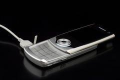 Téléphone portable argenté Images stock