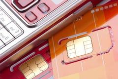 Téléphone portable avec des cartes de sim Photos libres de droits