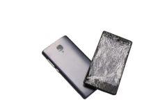 Téléphone portable avec un écran cassé Photo libre de droits