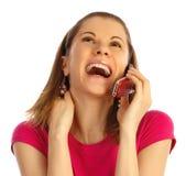 téléphone portable d'isolement par fille utilisant le blanc Photos stock