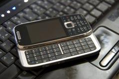 téléphone portable d'ordinateur portatif Photo stock