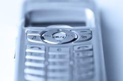 Téléphone portable dans l'instruction-macro Images stock