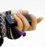 Téléphone portable dans la première main Photos libres de droits