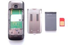 Téléphone portable dans les pièces photo stock