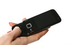 Téléphone portable dans une main 3 Photos libres de droits