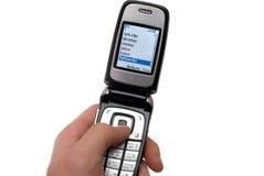 Téléphone portable dans une main Photos libres de droits