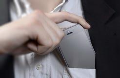 Téléphone portable dans votre poche Photographie stock libre de droits