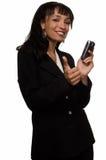 Téléphone portable de fixation de femme d'affaires Images libres de droits