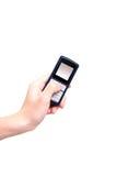 téléphone portable de main Photographie stock libre de droits