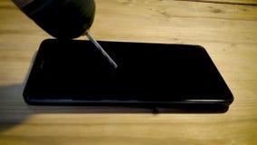 Téléphone portable de perceuse clips vidéos