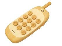 Téléphone portable en bois d'isolement sur le blanc Image stock
