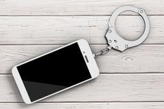 Téléphone portable enchaîné aux menottes en métal rendu 3d Image libre de droits
