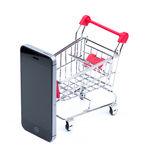 Téléphone portable et caddie image stock