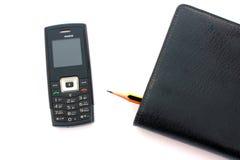 Téléphone portable et journal intime Photographie stock libre de droits
