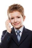 Téléphone portable parlant de garçon d'enfant Photo libre de droits