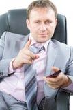 téléphone portable réussi de fixation d'homme d'affaires Image libre de droits