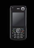 Téléphone portable sur le noir Images libres de droits