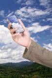 Téléphone portable sur le nuage Photographie stock libre de droits