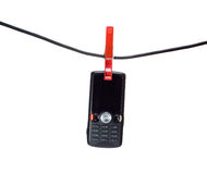 Téléphone portable sur une corde à linge Photographie stock libre de droits