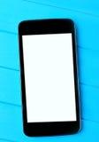 Téléphone portable vide sur la table Images stock