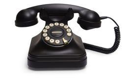 Téléphone rotatoire sur le blanc photographie stock