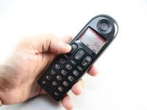 Téléphone sans fil en main Image stock