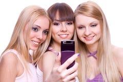 téléphone trois de filles Photographie stock libre de droits