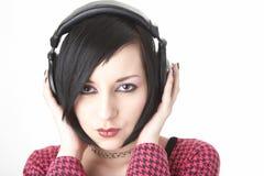 téléphones de tête de fille d'emo Image stock