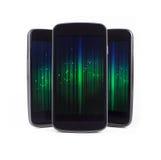 Téléphones intelligents multiples au-dessus de blanc photographie stock