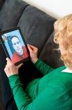 Téléphonie visuelle sur le PC de tablette de Digitals image libre de droits
