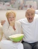 Télévision de couples. Images stock