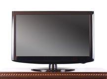 Télévision moderne sur le module en bois photos stock