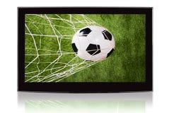 Télévision montrant le ballon de football et le filet Images libres de droits